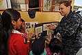 US Navy 110504-N-EP471-455 Hospitalman Jamie Lee talks with Peruvian children about the importance of proper hygiene and hand washing during a Cont.jpg