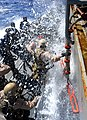 US Navy 110505-N-OS574-146 Marines climb into a rigid-hull inflatable boat during a visit, board, search and seizure, hook and pull exercise.jpg