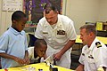 US Navy 110830-N-NT881-075 Sailors elp Taft Elementary School students learn the principles of buoyancy and sail design through the Science, Techno.jpg