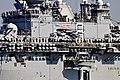 US Navy 111114-N-SH505-043 Sailors and Marines man the rails aboard the amphibious assault ship USS Makin Island (LHD 8) as the ship departs San Di.jpg