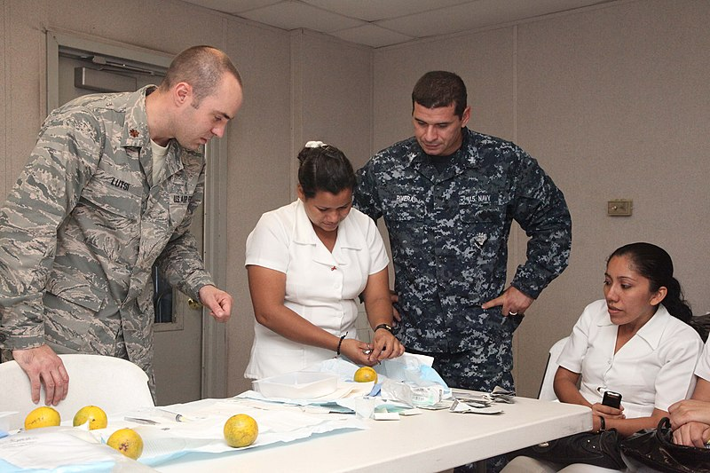 File:US Navy 111206-A-IP644-114 Maj. Brant Lutsi, left, a doctor assigned to High Speed Vessel (HSV) 2 Swift, and Petty Officer 2nd Class Miguel Rivera.jpg