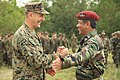 US Navy 111218-M-FW834-001 Col. Michael Hudson, commanding officer of the 11th Marine Expeditionary Unit (11th MEU), shakes hands with Malaysian Ar.jpg