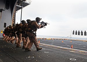 US Navy 120209-N-ZZ999-021 Marines assigned to Force Reconnaissance Unit engage targets on the aircraft elevator of the multipurpose amphibious ass.jpg