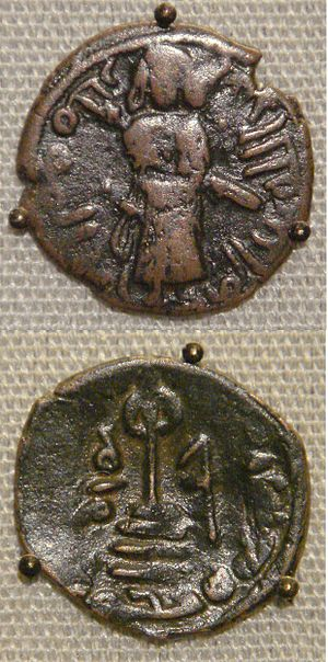 Umayyad Caliphate - Two coins of the Umayyad Caliphate, based on Byzantine prototypes. Copper falus, Aleppo, Syria, circa 695