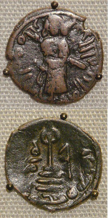 Two coins of the Umayyad Caliphate, based on Byzantine prototypes. Copper falus, Aleppo, Syria, circa 695 Umayyad calif Sassanian prototype copper falus Aleppo Syria circa 695 CE.jpg