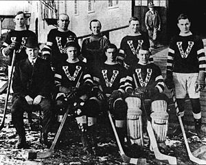 group of men posed in hockey uniforms outside