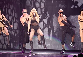 """Vogue"" was presented in a modernised style, with elements from contemporary R&B music VogueSticky&SweetTour2008 (cropped).jpg"