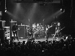 We Are the Fallen performing at Irving Plaza in New York City in 2010. Left to Right: John LeCompt, Marty O'Brien, Rocky Gray, Carly Smithson, and Ben Moody