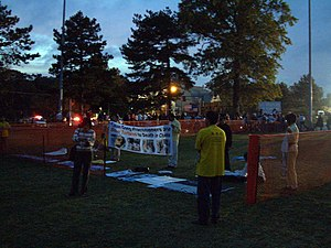 Free speech zone - Falun Gong protesters inside a fenced-off free speech zone at the 2000 Presidential Debate at Washington University