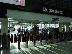 Waterloo station barriers with through ligths.JPG