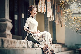 Culture of Vietnam - A Young Vietnamese woman wearing the traditional áo dài