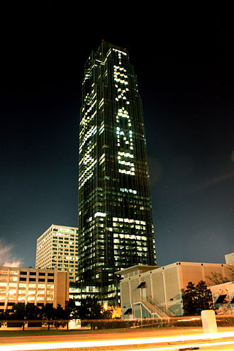 "Williams Tower - Williams Tower showing the word ""TEXANS"" using its office lights, the night before a Houston Texans game."