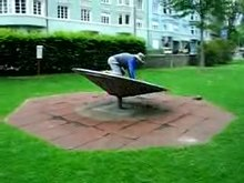 File:Wobble board anchored in a park.clip.ogv