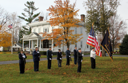 Members of American Legion Post #294 in front of the Wolcott House, the Italianate home of town founder Anson Wolcott.