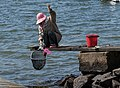 Woman fishing for shore crabs 4.jpg