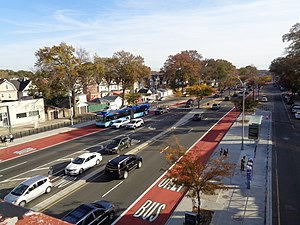 Woodhaven and Cross Bay Boulevards buses - Looking south down Woodhaven Boulevard, with a Q52 SBS bus (left), and new bus lanes and median bus stops used for Select Bus Service