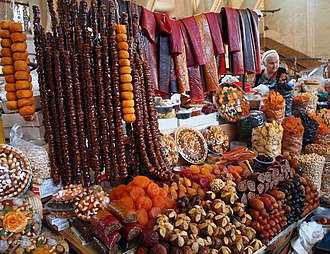 Armenian cuisine - Pestil/bastegh is a flat fruit leather, here seen sold alongside other dried fruit products at a market in Yerevan