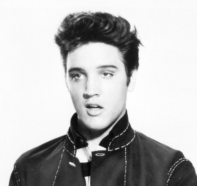 Elvis Presley with a long pompadour