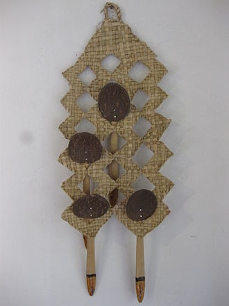 Spoon - Coconut shell spoons hanging in a traditional spoon hanger at a Sri Lankan home