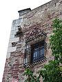 065 Església vella de Mont-roig del Camp, finestra amb reixa, pl. Joan Miró.jpg