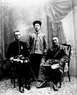 The 13th Dalai Lama of Tibet, British Political Officer Charles Bell (both seated), and Sidkeong Tulku Namgyal of Sikkim in 1910. 13th Dalai Lama, Sir Charles Bell and Maharaj Kumar Sidkeong Trul-ku.jpg