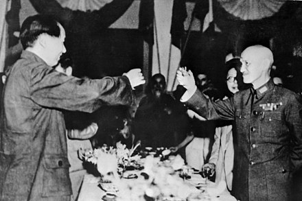 Chiang Kai-shek and Mao Zedong toasting together in 1946 following the end of World War II 1945 Mao and Chiang.jpg