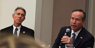 John L. Crain - Crain (left), listens while F. King Alexander, chancellor of Louisiana State University and president of the LSU System, responds to questions about funding for Louisiana's public universities, during a panel hosted by the Greater Hammond Chamber of Commerce.