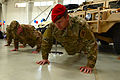 26th STS member push-ups at activation ceremony.jpg