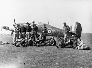 Pat Pattle - Pattle (sixth from the right, resting on his left elbow), with 33 Squadron c. 1941.
