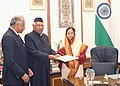 """A.R. Kidwai presenting the Report of """"The Committee of Governors to Study and Recommend Strategies for the Speedy Socio-Economic Development and Empowerment of Women"""", to the President, Smt. Pratibha Devisingh Patil.jpg"""
