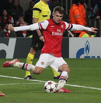 Kick (association football) - Aaron Ramsey of Arsenal kicking a football