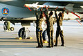 A 33rd Tactical Fighter Wing weapons crew loads an AIM-9 Sidewinder missile onto the wing pylon of an F-15 Eagle aircraft during the air-to-air weapons meet William Tell '84 DF-ST-85-09769.jpg
