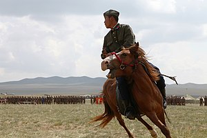 Mongolian General Purpose Force - A Mongolian soldier performs during the opening ceremony for exercise Khaan Quest 2013 at the Five Hills Training Area in Mongolia, August 3, 2013.
