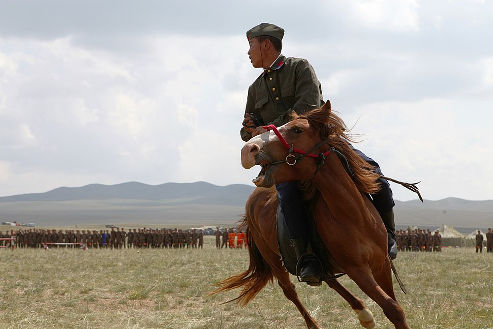 A Mongolian soldier performs during the opening ceremony for exercise Khaan Quest 2013 at the Five Hills Training Area in Mongolia Aug. 3, 2013 130803-M-MG222-004