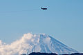 A U.S. Air Force C-130 Hercules aircraft assigned to the 36th Airlift Squadron flies over Yokota Air Base, Japan, during a routine sortie Jan. 10, 2014 140110-F-PM645-070.jpg