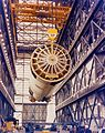 A crane lifts the Saturn first stage.jpg