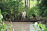 A farmer plies the waters of the Mekong Delta in southern Vietnam (9150050950).jpg