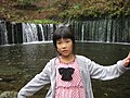 A girl in front of waterfall, Misaki, Japan; October 2011.jpg