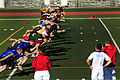 A group of competitors conduct warm-up exercises during a track and field training camp to prepare for the Marine Corps Trials at Camp Pendleton, Calif 130229-M-LM776-087.jpg