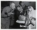 A member of the U.S. Air Force and an unidentified man entertain a child in a ventilator (12619337214).jpg