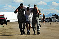 A simulated burn victim is helped to a triage center during an emergency management exercise at Davis-Monthan Air Force Base in Ariz 140226-F-ML420-138.jpg