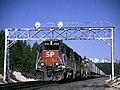 A southbound Z train speeds through Mowich, Oregon on UP's Cascade Line, Spring 1999.jpg