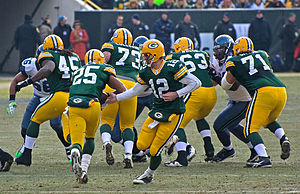 2009 Green Bay Packers season - Aaron Rodgers handing the ball off to Ryan Grant in their December 27, 2009 game.