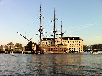 Nederlands Scheepvaartmuseum - A 1990 replica of the Amsterdam is moored next to the museum.