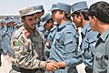 Afghan Brig. Gen. Abdul Raziq shakes hands with Afghan police instructors at Kandahar Regional Training Center .jpg