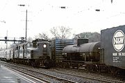 Amtrak #928, a former PRR GG1, speeds through North Elizabeth, New Jersey in December 1975.
