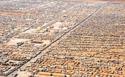 An aerial view of a portion of the Zaatari refugee camp which contains a population of 80,000 Syrian refugees. An Aerial View of the Za'atri Refugee Camp.jpg