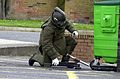 An Explosive Ordnance Disposal officer approaches a suspect device in full protective equipment during the troop's media open day held at their base in Goojerat Barracks, Colchester. MOD 45111100.jpg