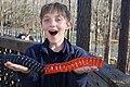 Andrew holding a huge gummy worm.jpg