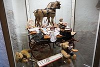 Antique toy horses, dolls, and musical bears (26165128140).jpg